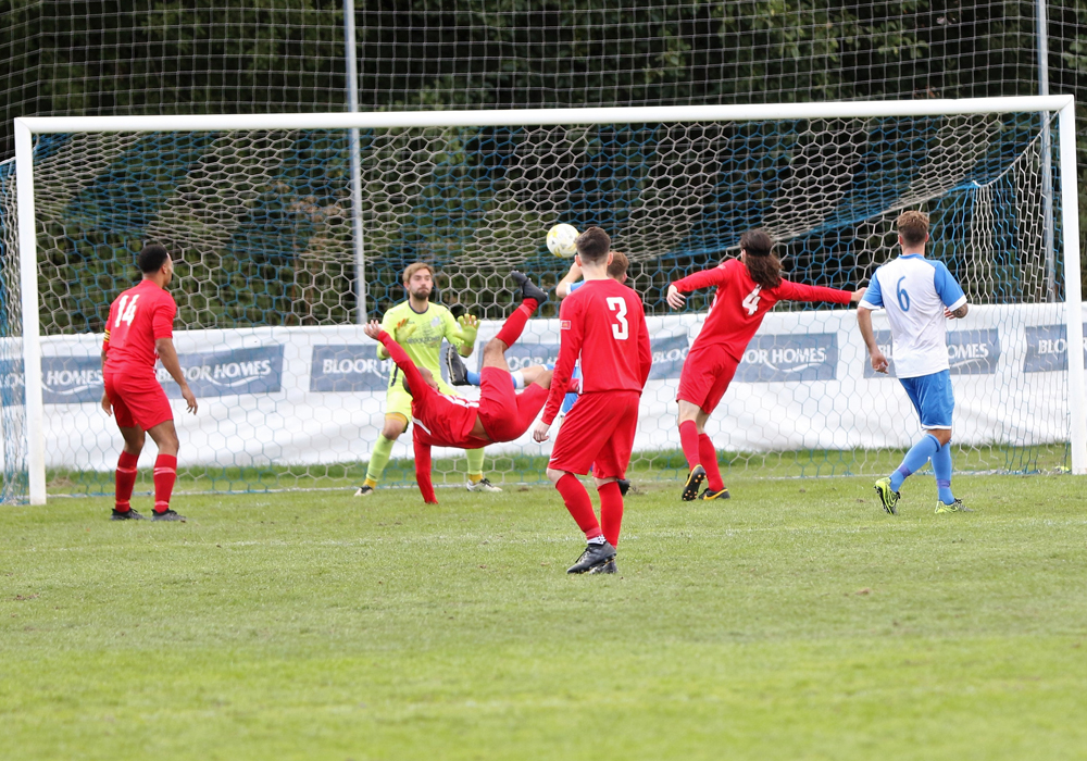 Bedfont & Feltham's Kelvin Karanja attempts an overhead kick against Eversley & California. Photo: Richard Milam.