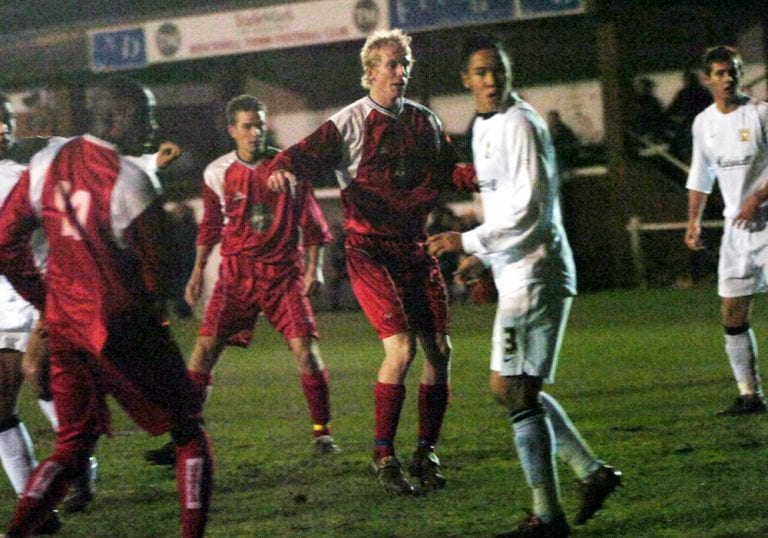 Michael Buck scores for Bracknell Town against MK Dons. Photo: Get Reading.