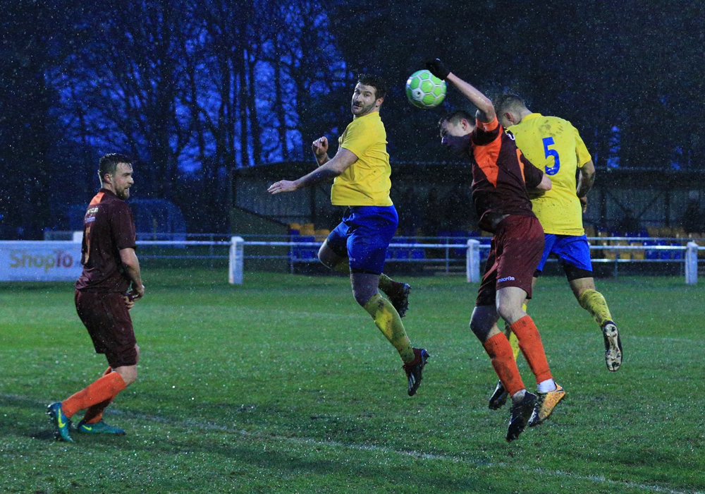 Fabienne Etienne (5) jumps highest to score for Ascot United. Photo: Rob Mack/Shooting Stars