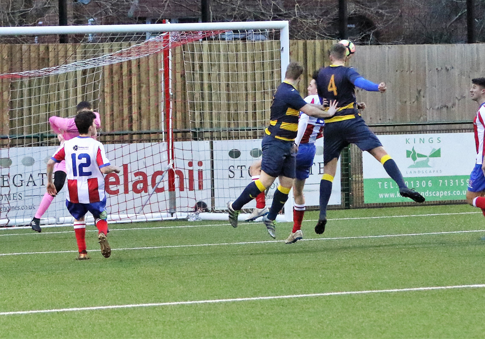 Ryan Whyte scoring with a towering header from a free kick. Photo: Richard Milam.