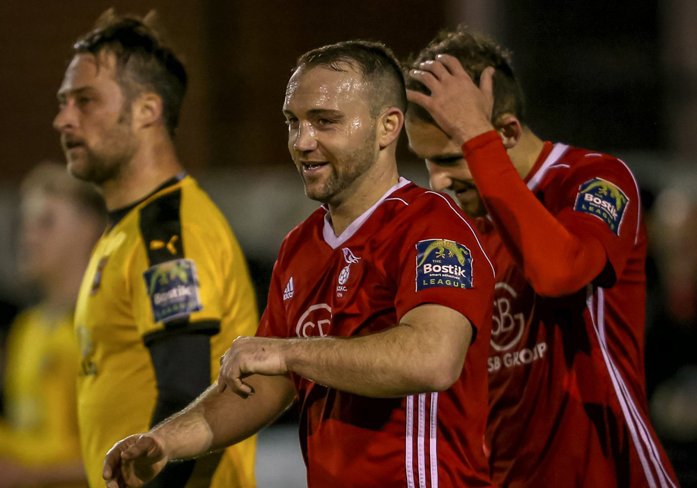 Jamie McClurg all smiles after Bracknell Town beat Folkestone Invicta. Photo: Neil Graham.