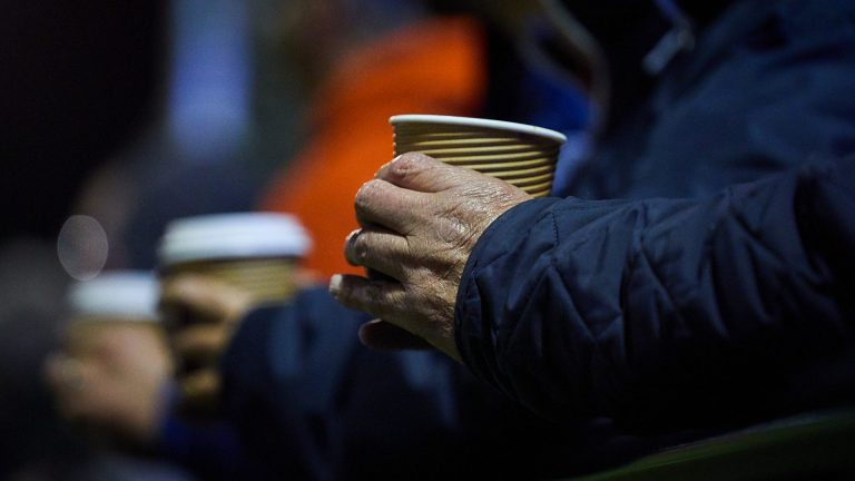 A supporter holds a hot cup of tea at a Berkshire non league match. Photo: Philip J.A Benton/philipbenton.com