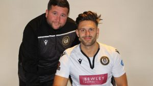 Luke Hopper signs for Hungerford Town. Photo: Ciaran Morrison.