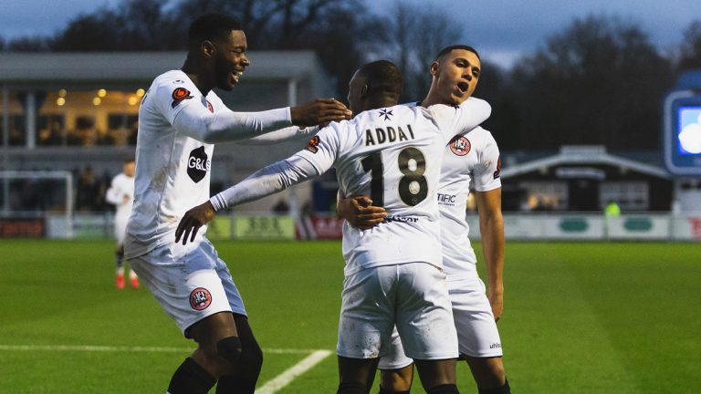 Alex Addai celebrates with his new Maidenhead United teammates. Photo: Darren Woolley / darrenwoolley.photos