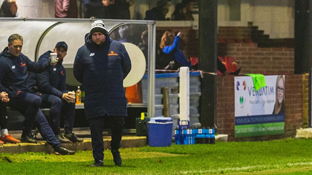 Hungerford Town boss Danny Robinson in the dugout. Photo: Darren Woolley / darrenwoolley.photos