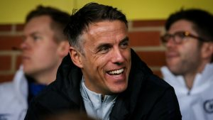 Phil Neville in the stands watching Chelsea vs Reading FC Women.