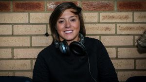 Fran Kirby in the commentary box for a Reading FC Women game at Wycombe Wanderers.