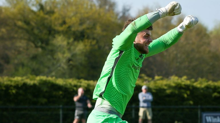 Chris Grace celebrates another penalty save for Binfield FC. Photo: Neil Graham / ngsportsphotography.com