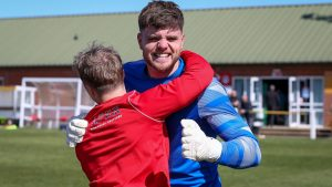 Chris Grace celebrates after Binfield's FA Vase penalty shoot-out win. Photo: Neil Graham / ngsportsphotography.com