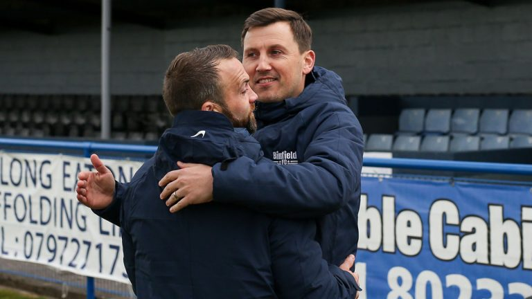 Carl Withers and Jamie McClurg embrace after the Long Eaton United win. Photo: Neil Graham / ngsportsphotography.com