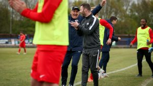 Roger Herridge celebrates in the Binfield FC dugout. Photo: Neil Graham / ngsportsphotography.com
