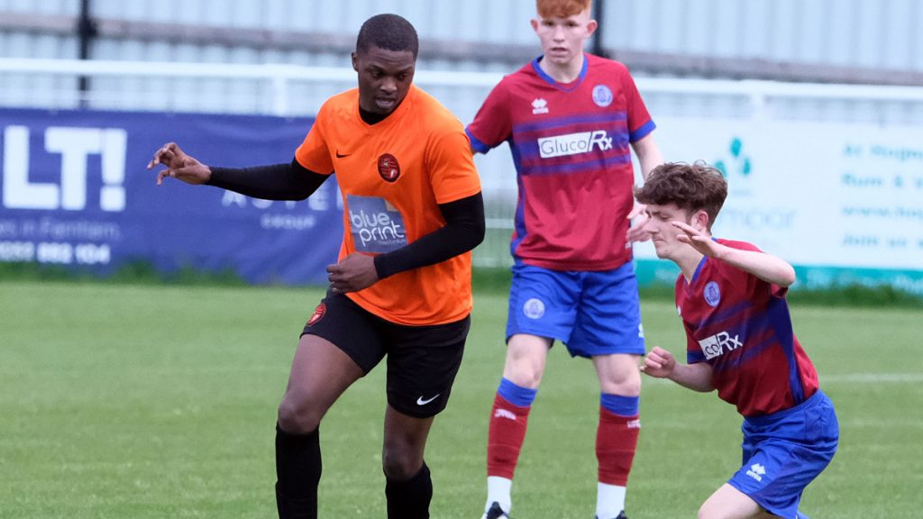 Bradley Ayisi in action for Wokingham & Emmbrook against Aldershot Town in the Allied Counties Cup Semi-Final. Photo: Andrew Batt.