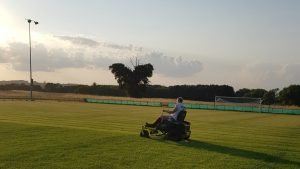 Grass cutting at Holyport's Summerleaze ground. Photo provided by club.