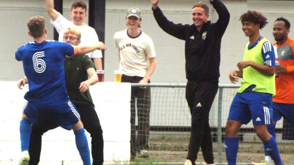 Alfie Grant celebrates scoring against Southall with the Reading City bench. Photo: Peter Toft.