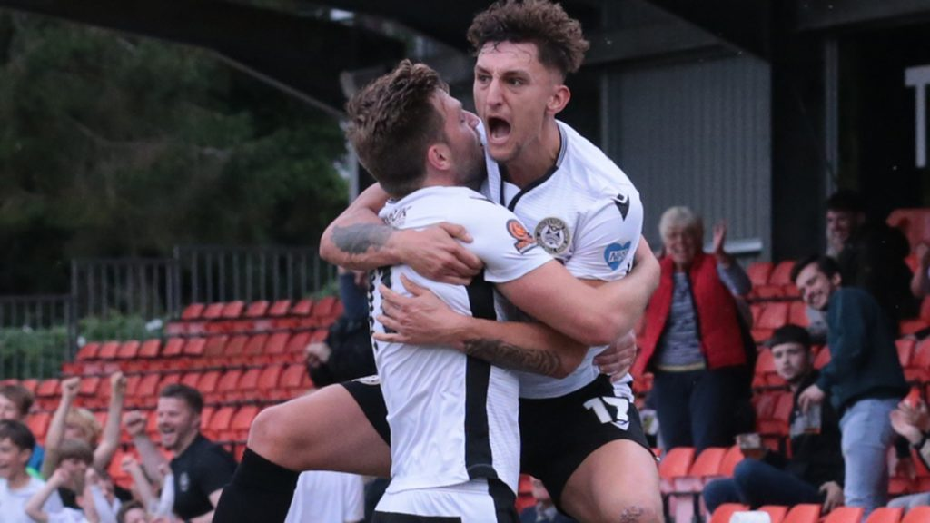 George Smith jumps for joy after scoring Hungerford Town's equaliser. Photo: Jeff Youd.