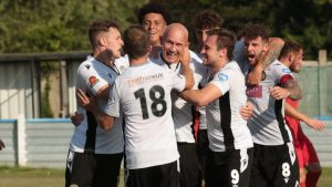 Keith Emmerson is mobbed after scoring for Hungerford Town in the FA Cup. Photo: Jeff Youd.