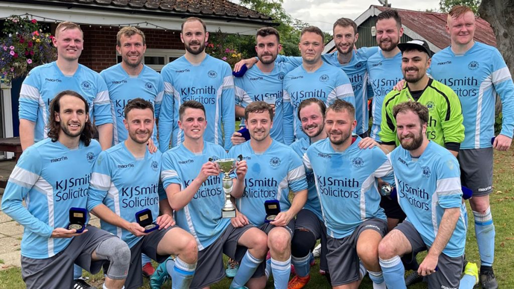 Woodley United lift the Sultan Balti Cup. Photo: Andrew Batt.