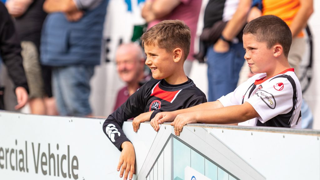 Young supporters in the crowd for Maidenhead United vs Dover Athletic. Photo: Darren Woolley / darrenwoolley.photos