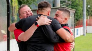 Lee Matthews celebrates with his Wallingford Town management team. Photo: Cameron Howard.