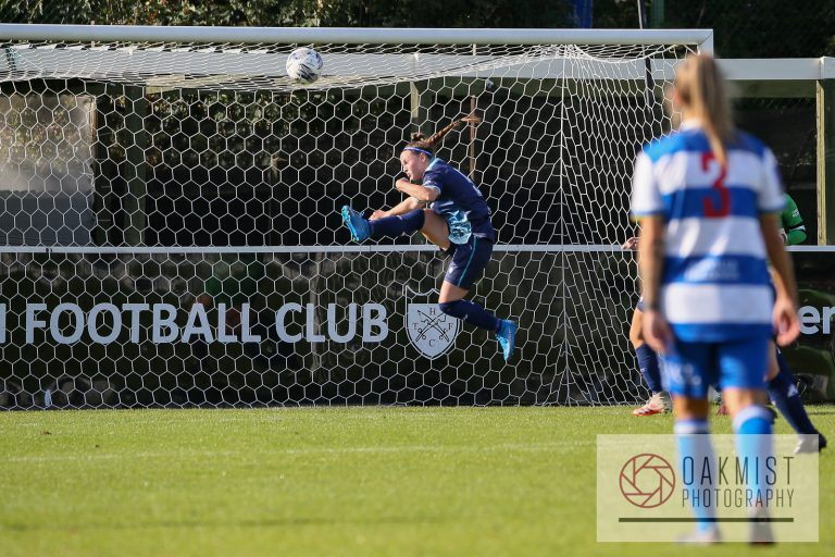 Sophie Wicks makes a clearance for Caversham United in their FA Cup fixture against QPR. Photo: Oakmist Photography